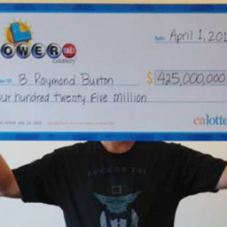 B. Raymond Buxton holding $425 million oversized Powerball check