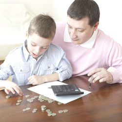 father and son counting money