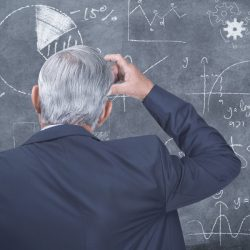 Confused man working on formula