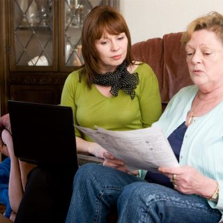 Mother and daughter working on a budget