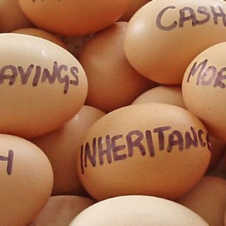 Eggs in a basket with financial terms