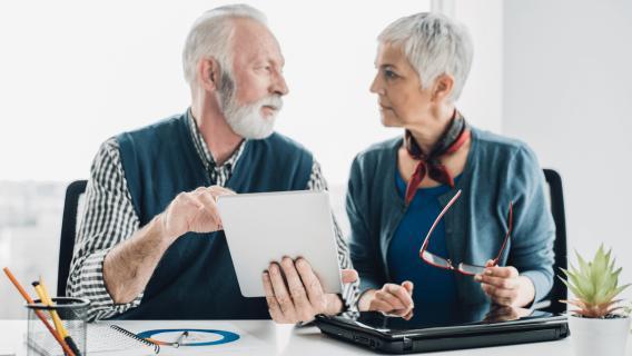 Seniors discussing annuity for retirement