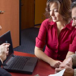 Broker has a discussion with two clients