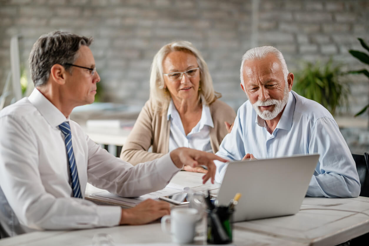 Broker discussing annuities with older couple