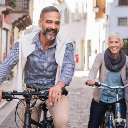 Retired couple exploring city on bicycles