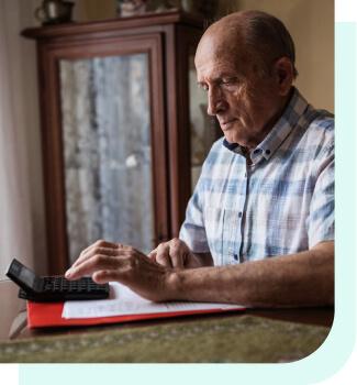 Older man using calculator