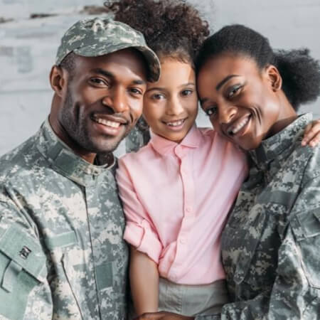 Soldiers embracing their daughter