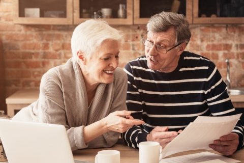 Happy older couple reviewing investments