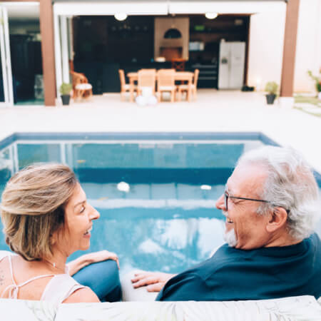 Elderly couple at a pool