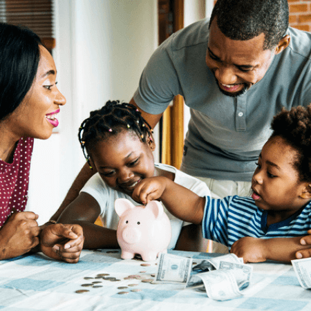 Black mother and father teaching their daughter and son about saving money