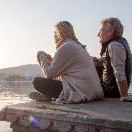 Older couple looks at sunrise