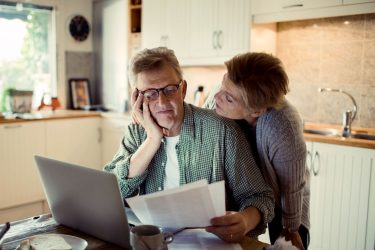 Older couple reviewing their finances