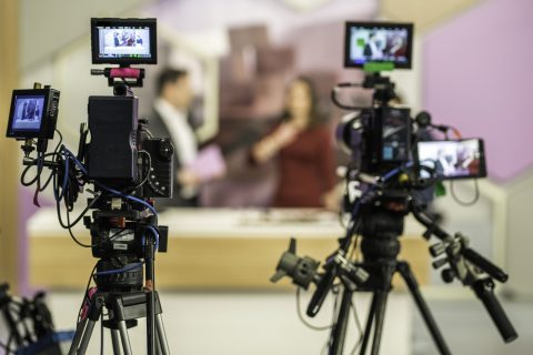 Two cameras filming