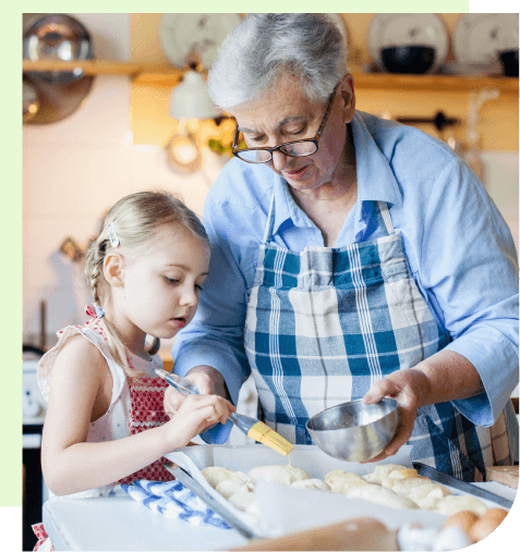 Grandmother baking with young grandchild